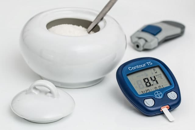 bowl of sugar and blood glucose reader
