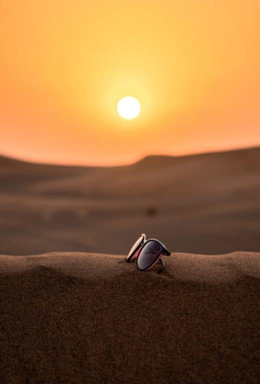 Sun glasses on a sand dune in the desert