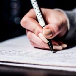 woman taking a written test