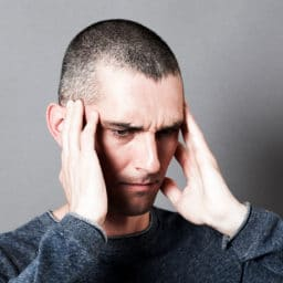 Man holding head in pain