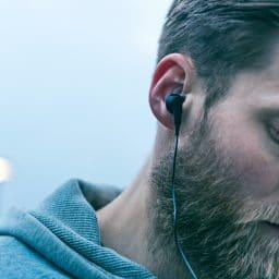 man wearing black ear buds