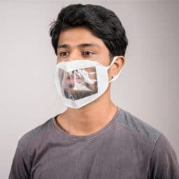 young man with transparent Medical face mask, to help hearing impermeant or deaf people to understand lipreading during coronavirus or covid-19 outbreak.